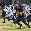 Woodlake cruised to a 55-27 victory over the visiting Farmersville Aztecs. Here Woodlake Tiger RB Alexander Marquez (13) turns the corner against Farmersville Aztec defender Johanny Torres (11).