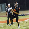 Woodlake cruised to a 55-27 victory over the visiting Farmersville Aztecs. Woodlake QB Eric Schwarz drops back to pass against Farmersville.