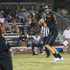 Woodlake cruised to a 55-27 victory over the visiting Farmersville Aztecs. Woodlake QB Eric Schwarz (10) drops back to pass during their contest with Farmersville.