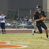 Woodlake cruised to a 55-27 victory over the visiting Farmersville Aztecs. Woodlake Tiger QB Eric Schwarz (10) rolls out to pass against the Farmersville Aztecs.