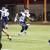 Woodlake cruised to a 55-27 victory over the visiting Farmersville Aztecs. Aztec RB Noah Garcia (4) looks for an opening.