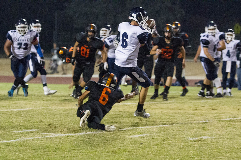 Woodlake cruised to a 55-27 victory over the visiting Farmersville Aztecs. Aztec WR Skyler Morris (8) takes a swing pass while Woodlake Tiger defender Rich Ramirez (6) attempts a tackle.