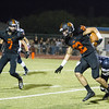 Woodlake cruised to a 55-27 victory over the visiting Farmersville Aztecs. Tiger RB Andrew Chavez (22) tries to escape the tackle of Aztec DB Anthony Castillo (3).