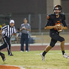 Woodlake cruised to a 55-27 victory over the visiting Farmersville Aztecs. Woodlake QB Eric Schwarz (10) rolls out to pass.