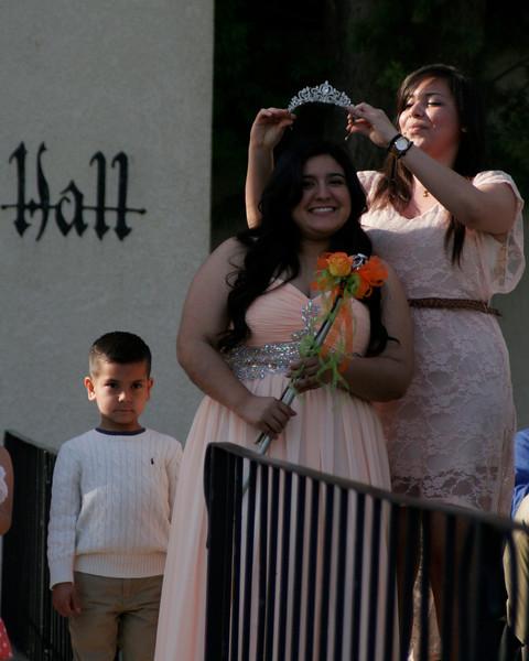 2013 Orange Blossom Festival queen Regina Alvardo presents the crown to 2014 OBF Queen Jocelyn Jauregui.