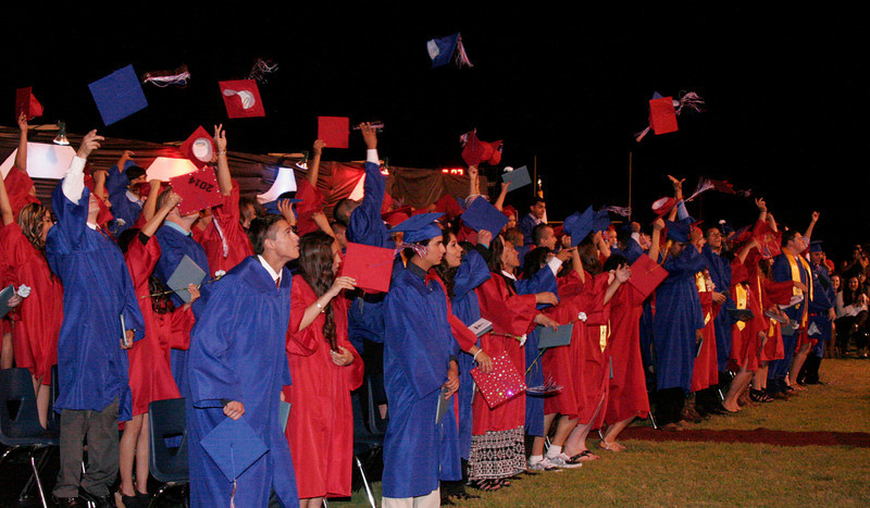 Strathmore High School 2014 graduates let their caps fly at the conclusion of the Spartan commencement ceremony.