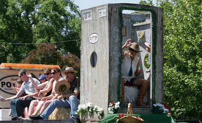 The Potter's-Porta-Pottie entry in the 2014 Woodlake Lions Rodeo Parade included an outhouse that was short one door!