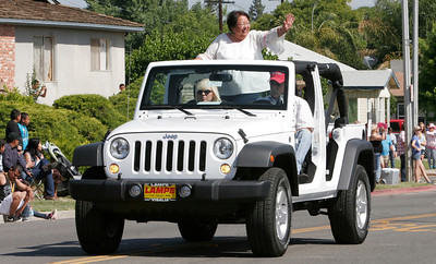 2014 Woodlake Lions Club Rodeo Grand Marshall Francis Mann waves to the crowds lining Valencia Blvd.