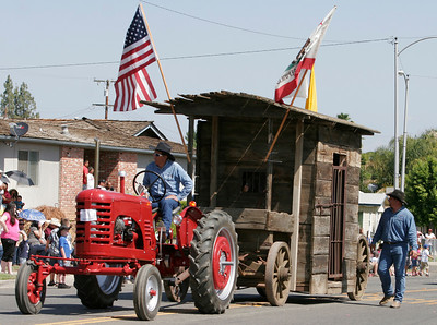 "The Laton Lions Club Rodeo members put various Woodlake diginitaries in the ""jail"" wagon as the proceeded down Valencia Blvd. during the 2014 Woodlake Lions Rodeo Parade."