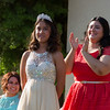 2014 Orange Blossom Festival Queen applauds after giving up her crown to 2015 Orange Blossom Festival Queen Dulce Diaz.