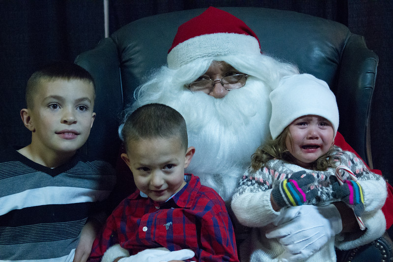 Different reactions to visiting with Santa Claus at the annual Lindsay Police Christmas Toy Giveaway.