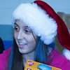 A member of the Lindsay High ASB is all smiles as she hands out toys at the annual Lindsay Police Christmas toy giveaway.