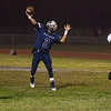 Farmersville scored a 41-39 victory over the visiting McFarland Cougars  behind a 163-yard and 1 TD effort by Victor Castrejon.  Aztec QB Leo Alvarez (2) drops back to pass.