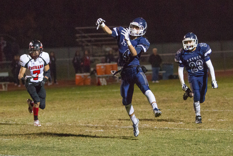 Farmersville scored a 41-39 victory over the visiting McFarland Cougars  behind a 163 yard and 1 TD effort by Victor Castrejon. Castrejon (4) also completed this pass for 12 yards during the Aztec victory.