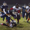Farmersville scored a 41-39 victory over the visiting McFarland Cougars behid a 163 yard and 1 TD effort by Aztec Victor Castrejon. Here Castrejon (4) dives for additional yardage.