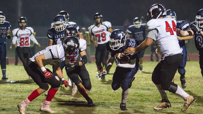 Farmersville scored a 41-39 victory over the visiting McFarland Cougars carried by a 163 yard and 1 TD effort by Victor Castrejon. Farmersville RB Matthew Rodriguez (23) rushed for 90 yards and a TD in the Aztec win.