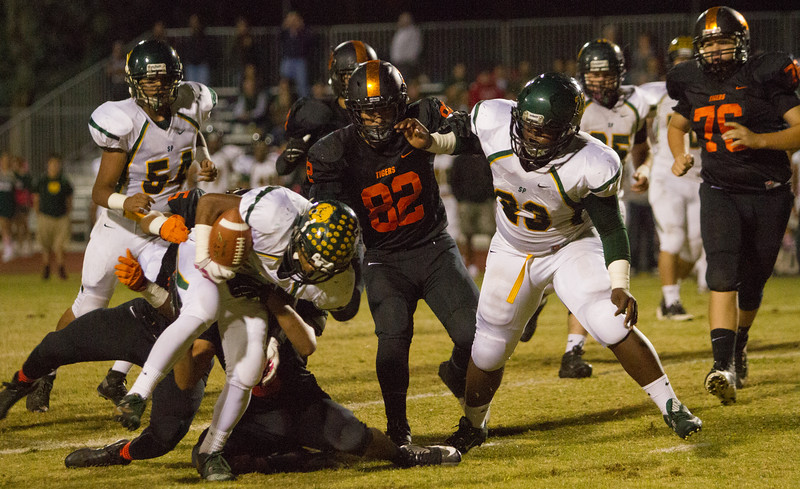 The Woodlake Tigers defeated the Sierra Pacific Golden Bears 31-20 to remain undefeated in ESL play.