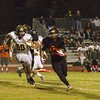 Sierra Pacific Golden Bear MLB Hunter Carbal (50) chases Woodlake's Alexander Marquez in ESL play. The Woodlake Tigers scored a 31-20 victory over the Golden Bears.