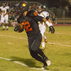Woodlake Tiger TE Marin Apodaca III caught two touchdown passes in the Tigers' 31-20 victory over Sierra Pacific in East Sequoia League play.