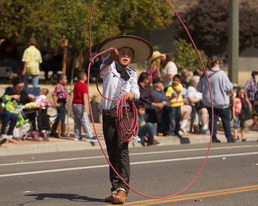 A young trick roper performs during the 2015 Woodlake Lions Rodeo parade.