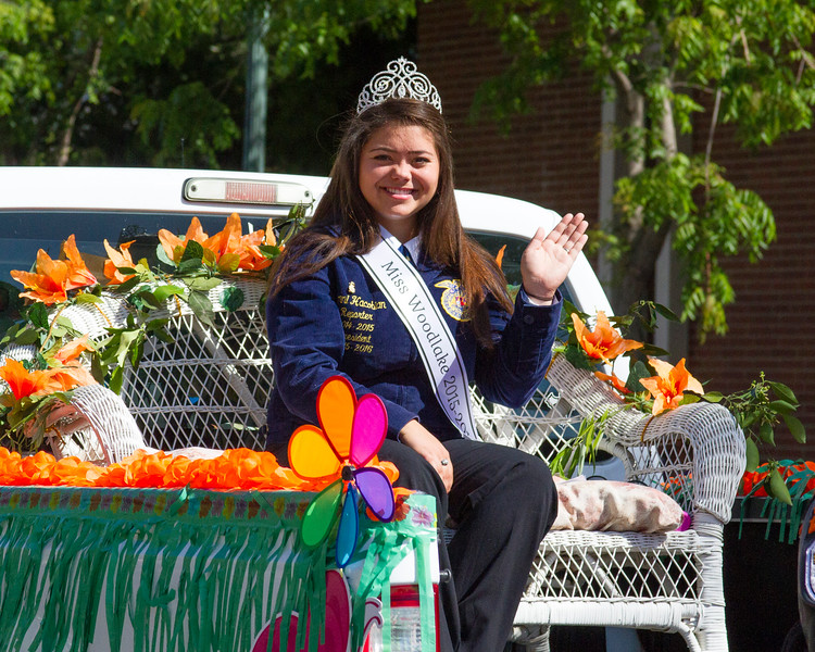 Participants in the 2016 Lindsay Orange Blossom Festival parade. Miss Woodlake 2015-2016 Sonni Hacobian is all smiles as she wave to the crowds lining the street of Lindsay for the OBF parade.