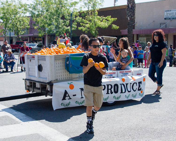 Participants in the 2016 Lindsay Orange Blossom Festival parade. A & N Produce passed out Lindsay's signature crop, oranges, along the 2016 Orange Blossom Festival Parade route.