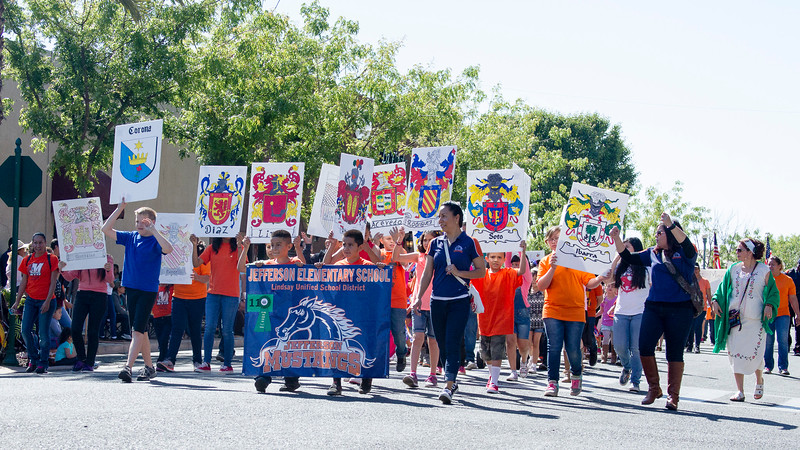 Participants in the 2016 Lindsay Orange Blossom Festival parade. The Jefferson Elementary School showed the crowds lining the parade route their family crests.