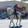 Participants in the 2016 Lindsay Orange Blossom Festival parade. This trick ropers show his skills while proceeding along the OBF parade.