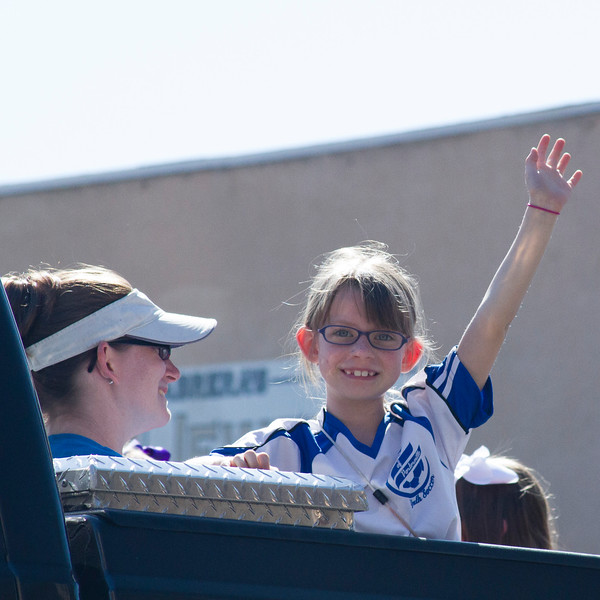 Participants in the 2016 Lindsay Orange Blossom Festival parade. This parade participant is all smiles as she wave to the crowd during the 2016 Orange Blossom Festival Parade.