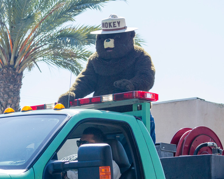 Participants in the 2016 Lindsay Orange Blossom Festival parade. Smokey the Bear rode in the back of a US Forest Service truck in the 2016 Orange Blossom parade.