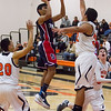 Strathmore scored a 71-55 league victory at Woodlake in each team's ESL opener. Spartan Seth Aparicio (1) shoots over the out stretched arm of Woodlake defender G.G. Gonzalez (32).