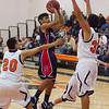 Strathmore scored a 71-55 league victory at Woodlake in each team's ESL opener. The Spartans scored repeatedly in the paint.