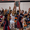 Strathmore scored a 71-55 league victory at Woodlake in each team's ESL opener. Woodlake guard Jacob Varela puts up a shot against a host of Strathmore defenders.