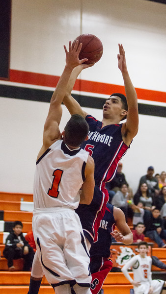 Strathmore scored a 71-55 league victory at Woodlake in each team's ESL opener. Strathmore's Carlos Lopez (5) drives the paint against Woodlake guard Jacob Varela (1).