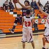 Strathmore scored a 71-55 league victory at Woodlake in each team's ESL opener. Strathmore C/F Arturo Topete (23) flies through the paint against Woodlake's Jacob Moriado (23).