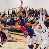 Strathmore scored a 71-55 league victory at Woodlake in each team's ESL opener. Strathmore Spartan Carlos Lopez (5) puts up a fall-away jumper against the Woodlake Tiger defense.