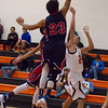 Strathmore scored a 71-55 league victory at Woodlake in each team's ESL opener. Strathmore center Arturo Topete (23) goes up for a block against a Tiger shot.