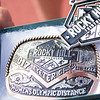 A close up view of Teresa Lovero's winner's belt buckle as the overall women's winner at the Olympic distance of the 3rd Annual Rocky Hill Triathlon held on Saturday, March 11.
