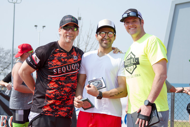 Michael Kezian, of Los Angeles, is presented the winner's belt buckle as the overall male winner of the sprint distance of the 3rd Rocky Hill Triathlon. Presenting the award are (l to r) James Wilson and  Race Director Charles Duby.