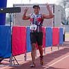 Michael Sanchez, who competes for the Triathlon Club of Central California, is all smiles as he crosses the finish line of the 3rd Annual Rocky Hill Triathlon.