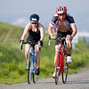 Jim Smith (154) of Exeter and Kelsey Western (409) cycle up Rocky Hill during the 3rd Annual Rocky Hill Triathlon held on Saturday, March 11th.