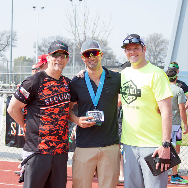 Sequoia Orange's James Wilson and Race Director Charles Duby flank Men's Olympic overall winner, Sam Aleman, at the awards presentation for the 3rd Annual Rocky Hill Triathlon.