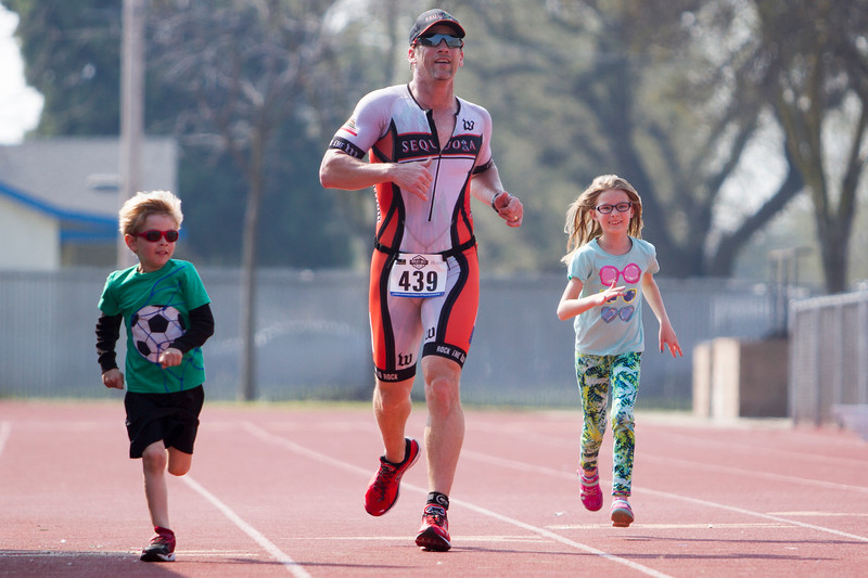 Sequoia Orange's James Wilson finishes the Olympic distance of the 3rd Annual Rocky Hill Triathlon with his children. Sequoia Orange is the organizer and a sponsor of the annual Rocky Hill Triathlon.