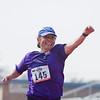 Gracie Johnson (bib 145) of Tulare celebrates finishing the 3rd Annual Rocky Hill Triathlon.