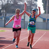 Kaylyn Wightman (125) from Sequoia National Park and Kelly Matson (139) of Exeter celebrate crossing the finish line of the 3rd Annual Rocky Hill Triathlon. They competed at the sprint distance of the event.