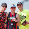 James Wilson and  Charles Duby present a belt buckle to Stacy Hyde as the Women's Sprint Distance winner of the 3rd Annual Rocky Hill Triathlon.
