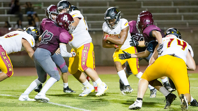 Tulare Union RB James White IV squeezes for every yard in the Redskin's opening game against the Mt. Whitney Pioneers. Tulare Union went on the a 57-6 victory.
