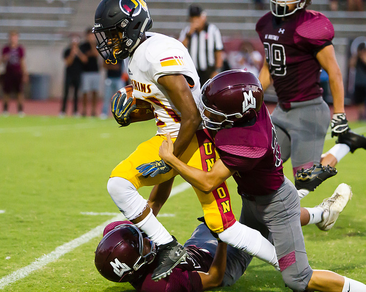 TU Redskin Runningback Donavon Smith (31) tries to escape the tackle of Mt. Whitney Pioneer DB Jared Banuelos. Tulare Union went on to a 57-6 win.