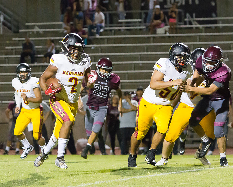 Tulare Union RB James White runs for a late touchdown in the Redskin's 57-6 drubbing of the host Mt. Whitney Pioneers.