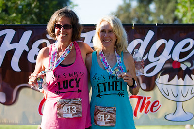 Lucy and  Ethel,  Kris Edwards (913) and  J. Sheela Suater  of Bakersfield, pose in front of the Visalia Hot Fudge Sundae 5K Race banner.  The Hot Fudge Sundae Run was held on Sunday, August 18th at Mooney Grove Park in Visalia.